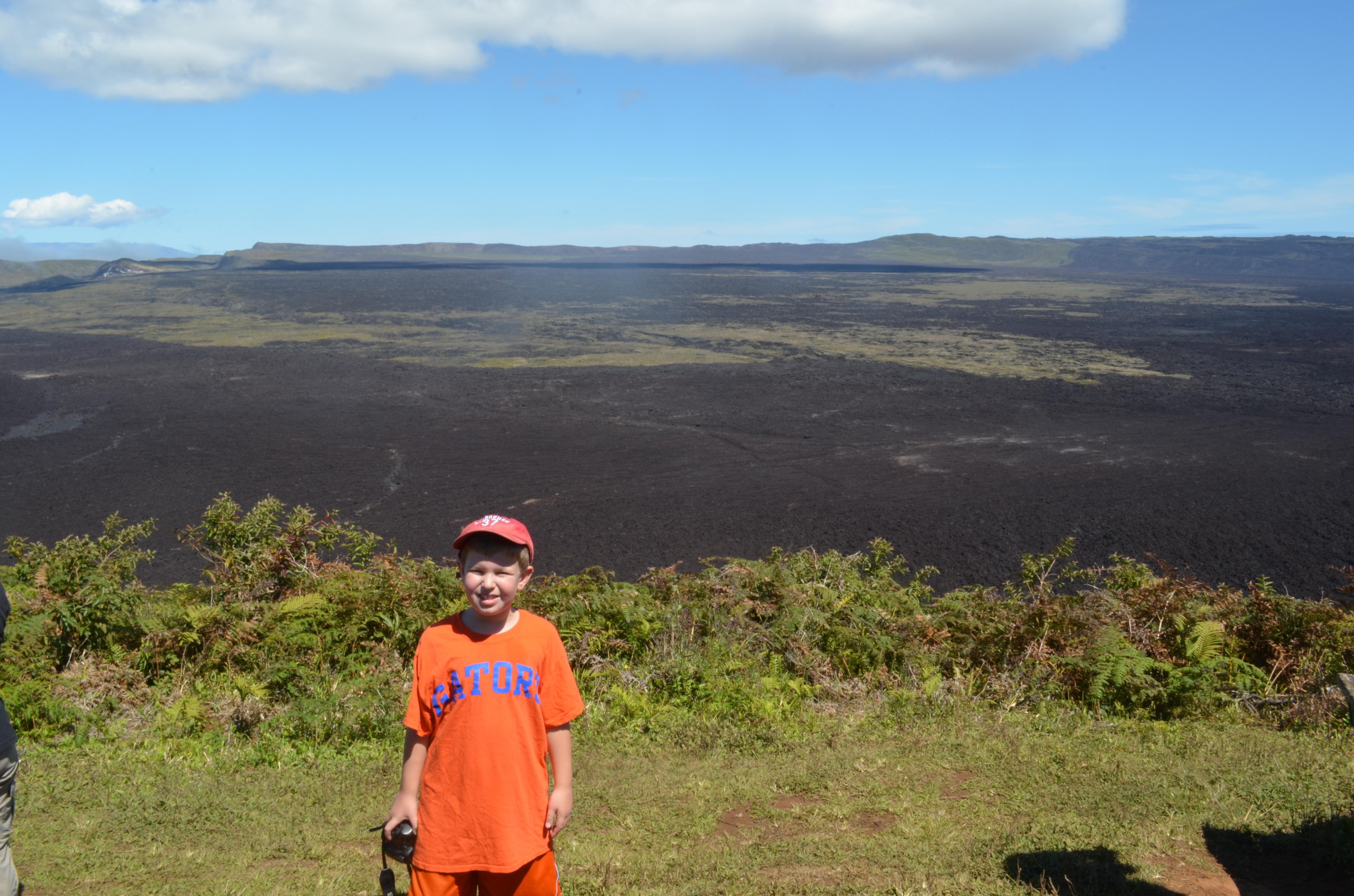 standing next to volcano